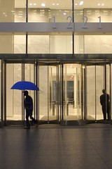 the blue brolly (Towner Images) Tags: ny nyc us usa towner manhattan townerimages newyork bigapple building architecture design city urban america light lighting illumination umbrella 1221 rain raining avenueoftheamericas wallaceharrison