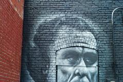 Bricks & Bolts (jshyshka) Tags: strange face wall voigtlander brick leica m8