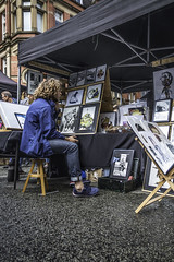 The artist and his work for sale (tootdood) Tags: canon70d stevenson square manchester streetcandid artist work for sale people sitting sit sat seated stool fromthehip