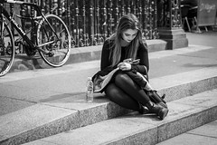 Social Media (Leanne Boulton) Tags: monochrome people portrait urban street candid portraiture streetphotography candidstreetphotography candidportrait streetportrait streetlife woman girl female pretty face facial expression look emotion feeling sitting posture mobile phone social media beauty beautiful eyelashes hair shape form composition tone texture detail depthoffield bokeh naturallight outdoor light shade shadow city scene human life living humanity society culture canon canon5d 5dmarkiii 70mm character ef2470mmf28liiusm black white blackwhite bw mono blackandwhite glasgow scotland uk