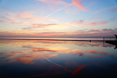 A Leap into the Mirror (JamieHaugh) Tags: clevedon northsomerset england uk sony a6000 lake marine outdoors clouds color red sunset evening water mirror sky britain