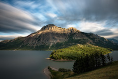 Waterton Lakes National Park, Alberta Canada (B.E.K.) Tags: waterton lakes national park alberta canada prince wales hotel lake clouds sky mountain field grass trees outdoor landscape longexposure
