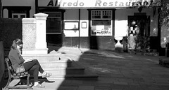 Waiting for Alfredo (TERRY KEARNEY) Tags: waitingforalfredo blackandwhite monochrome shadows people female conwy wales northwales buildings canoneos1dmarkiv daylight day daytime explore europe flickr kearney landscape oneterry outdoor reflections sunshine terrykearney trees