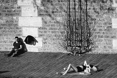 iParis: distraction (gregjack!) Tags: france paris people sunbathing sun textures wall distraction street streetphotography bnw bw sony rx10m3