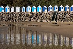 Alignement de plage (Lucille-bs) Tags: europe france normandie manche barnevillecarteret plage cabine sable reflet flaque eau alignement escalier bleu carteret autofocus