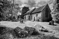 Together in death (David Feuerhelm) Tags: nikkor blackandwhite bw contrast silverefex infared building church tower old historic history churchyard graves tombstones atmospheric suffolk nikon d90 wideangle