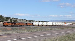 Made up of mostly JB Hunt containers, the Z-LACWSP6-28 races along Route 66 climbing out of the Aubrey Valley. (DTR CEO) Tags: route66 audley aubrey arizona stacks bnsf locomotive jb hunt jbhunt transcon