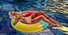 Chillaxing (MissZafire) Tags: beach pool relaxing chilling babes girl woman female bikini tube water sun