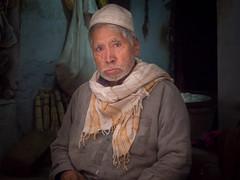 Peshawar, Pakistan (Shahid A Khan) Tags: red peshawar pakistan shopkeeper man old stare kpk khyberpukhtoonkhuwa street photography portrait sakhanphotography shahidakhan olympus em10mark2