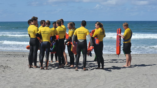 springclassic openwaterswim ocean pacific wetsuit oceanside lifeguards beach yellow jersey young group junior wrapup
