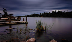 Calm Before the Storm (fuzzy_dunlop_nola) Tags: longexposure louisiana jeanlafitte fuji xt2 fujifilm fishing cloudy storm cloud fujixt2 southlouisiana weather dusk evening fujinon fujifilmxt2 waterscape landscape pier clouds serene serenity calm waterfront light shore blue lafitte wideangle shoreline rain rural xf14mmf28r view mood color colors bayou town 14mm dock wharf landing scape smooth rocks jeanlafittelouisiana intracoastalwaterway wind windy dark
