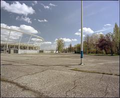 Chorzów, Poland. (wojszyca) Tags: mamiya rz67 6x7 120 mediumformat 50mm polariser bw kodak portra 160 gossen lunaprosbc epson v800 city urban landscape concrete space stadium pole