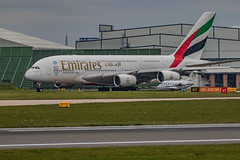 Little and Large (21mapple) Tags: airbus a380 emirates manchester manchesterairport airport aircraft airplane aeroplane plane jumbo jet engine windows wing