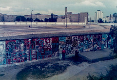 img069-1 Wallart - grafitti, Berlin Wall (Lawrence Holmes.) Tags: nikon ftn film scan 1985 berlin wall checkpoint charlie checkpointcharlie east west gdr coldwar germany nato lawrenceholmes