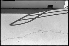 Notches, curves, angles, shadows (FreezerOfPhotons) Tags: leicam5 leica leitz cosinavoigtlandernokton40mmf14sc singlecoatedlens fujineopan400 legacypro xtol notch shadow diagonal loop curve crack concrete