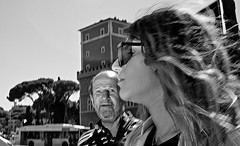 Center of attention! (Baz 120) Tags: candid candidstreet candidportrait city candidface candidphotography contrast colour street streetphoto streetcandid streetphotography streetphotograph streetportrait rome roma romepeople romestreets romecandid europe women monochrome monotone mono blackandwhite bw noiretblanc urban voigtlandercolorskopar21mmf40 voightlander life leicam8 leica primelens portrait people unposed italy italia grittystreetphotography flashstreetphotography flash faces decisivemoment strangers
