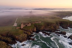 Slains Castle in the mist (iancowe) Tags: slainscastle slains castle crudenbay aberdeenshire porterroll dracula bramstoker peterhead cliff clifftop cliffs ruin ruins mist fog morning dawn twilight sunrise sea granite pink scotland scottish drone aerial dji phantom 4 pro waves north