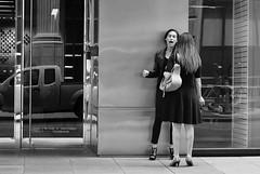 Smokers Disagreement (burnt dirt) Tags: houston texas downtown town city mainstreet street sidewalk corner crosswalk streetphotography fujifilm xt1 girl woman people person bag purse phone cellphone walking standing talking waiting bw blackandwhite couple pair smoke smoking cig cigarette heels boots mouth