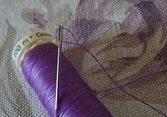 For Macro Mondays:  of camels and needles  HMM! (quietpurplehaze07) Tags: cotton cottonreel purple eye needle camels macrosmonday