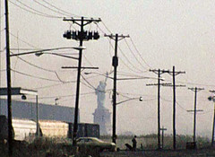 The Statue of Liberty framed by crookedly leaning telephone poles, three train cars, Jersey swamps, a 1970s Chevy and what appears to be a man walking a dog. Caven Point Road. Jersey City. April 1976 (wavz13) Tags: oldphotographs oldphotos 1970sphotographs 1970sphotos oldphotography 1970sphotography vintagesnapshots oldsnapshots vintagephotographs vintagephotos vintagephotography filmphotos filmphotography newyorkphotographs newyorkphotos oldnewyorkphotography oldnewyorkphotos vintagenewyork railroadphotos railroadphotography railroads vintagerailroads vintagerailroadphotography oldrailroads oldrailroadphotography depressing bleak noir noire jerseycityphotographs jerseycityphotos oldjerseycityphotography oldjerseycityphotos oldjerseycity vintagejerseycity vintagejerseycityphotography jerseycityhistory newjerseyphotographs newjerseyphotos oldnewjersey vintagenewjersey newjerseyhistory urbanphotography urbanphotos urbanscenes gloomy urban grain grainy industrialjerseycity urbanwasteland abandonedrails abandonedrailroads abandonedtracks urbandecay urbanblight vintagecars vintagecar oldcar oldcars 1970scars collectiblecars collectablecars 1960scars abandoned abandonment
