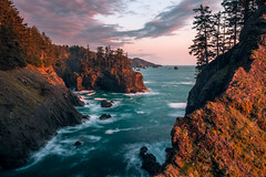 Power of Endurance (mark5photographic) Tags: seascapes sea sunset sun ocean orange oregoncoast outdoors coast long water trees clouds