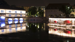 in a time when fortifications become decoration (lunaryuna) Tags: france lalsace strasbourg architecture medievalarchitecture defence canal wall barragevauban reflections water seeingdouble illumination nightlights citylightssobright colours nightphotography nocturnalphotography urbanconstructs walkinthecity lunaryuna