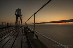"""YOU DON'T ALWAYS GET WHAT YOU WANT"" (lynneberry57) Tags: sunrise whitby pier sea tide water lighthouse sky clear nature light canon 70d leefilters longexposure seascape landscape sun colour rails northyorkshire uk"