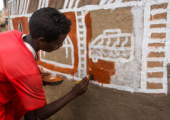 Young man painting the wall of a traditional ethiopian house, Kembata, Alaba Kuito, Ethiopia (Eric Lafforgue) Tags: abyssinia adolescent africa african alaba architecture art artist building color culture day decorated decoration depiction eastafrica ethiopia ethiopian ethnic geometric home horizontal hornofafrica house housing hut illustration kulito mural naive oneperson outdoors painted painter painting people poverty skill teenager toukoul tukul village work working youngadult ethio163439 alabakuito kembata