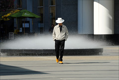 walkabout (me*voilà) Tags: man walking hat fountain plaza