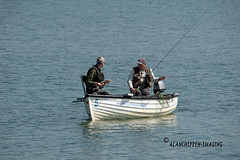 Two men in a Boat (Alanchippyh) Tags: boat water blue gray white reflections reservoir fishing troutfishing outdoor
