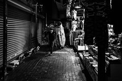 working the streets / late but there's always time (Özgür Gürgey) Tags: 2017 20mm bw d750 darkcity eminönü nikon voigtländer candid lines lowlight night shadow street working istanbul turkey respect