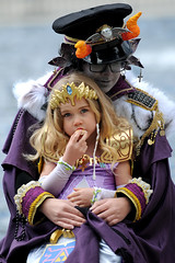 Mommy's Little Princess (Poocher7) Tags: cosplay cosplaygirls cute lovely pretty momanddaughter motherandchild portrait people outdoors sitting relaxing eating princess orange horns costumes purple purpledresses crossearings comicon2017 kitchenercomicon2017 kitcheneron beautiful sweet heartwarming adorable