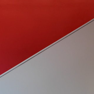 Red wall, white staircase
