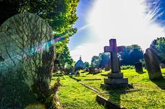 divine light (I was blind now I see!) Tags: graveyard gravestones cross chapel grass sky blue light refraction trees sun