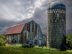 Resting And Rusting (henryhintermeister) Tags: barns minnesota oldbarns clouds farming countryliving country sunsets storms sunrises pastures nostalgia skies outdoors seasons field hay silos dairybarns building architecture outdoor winter serene grass landscape plant cloudsstormssunsetssunrises