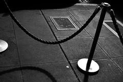 Seattle sidewalk (Tim Scotford) Tags: seattle sidewalk pavement mono monochrome bw pikeplace market