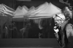 Harmoni-walker (RaminN) Tags: monochrome oregon portland pdx reflection glass street harmonica playing man