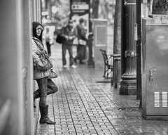 Connection (Ian Sane) Tags: ian sane images connection eye contact woman staring chilling waiting max train trimet public transportation mass transit rain black white monochrome candid street photography downtown portland oregon canon eos 5d mark ii two camera ef70200mm f28l is usm lens