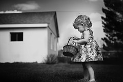 Checking her inventory... (Kapuschinsky) Tags: blackandwhite bnw monochrome fineart fineartportrait portraiture childportrait girl baby curls texture hair lifestyle documentary candid basket outside outdoors naturallight sonyalpha sonya900 minoltag minolta pennsylvania easter spring springtime emotive moody cute nostalgic kapuschinsky sonyphotographing