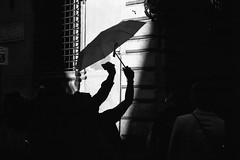 Under my umbrella I'm an accomplished exile (Roberto Urso) Tags: analog film filmphotography blackandwhite yashica kodak trix400 umbrella incubus light shadow silhouette arms people italy rome street streetphotography