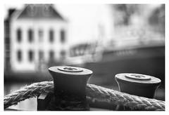 The harbour (leo.roos) Tags: bolder meerpaal deckfittings bitts mooringlines hawsers harbour haven ships schepen rope touw boat boot noiretblanc maassluis a7s rousselparisanastigmatprojectiontraiteseriepf127mmf35 projectorlens projectionlens day127 dayprime dayprime2017 dyxum challenge prime primes lens lenzen brandpuntsafstand focallength fl darosa leoroos