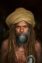 2e6ce5f34c98e1f227bbe59ed197eae0 (clemencebouchez) Tags: india indian march 2010 kumbhmelafestival festival vertical portrait outdoors outside exterior adult man sadhu turban long hair beard mustache dreadlocks dreads chest scar scarred scars necklaces beads string orange gray graying yellow beards bearded scarf headscarf metal ring dsc3055 india10872