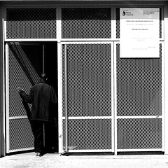 By escaping from the street (pascalcolin1) Tags: paris13 homme man rue street escaping séchappant lumière light ombre shadow photoderue streetview urbanarte noiretblanc blackandwhite photopascalcolin grille carré square