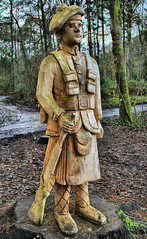 eco warrior on guard (Duncan the road rebel) Tags: woodcarving wood carving soldier military forest scottish scottishsoldier ecowarrior eco warrior chainsawart chainsaw art artwork woodwork outdoor outside streetart battledress kiltedsoldier mili tar militarydress onguard