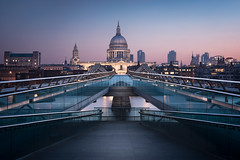 Allegro by Otto Berkeley - Revisiting a vantage point which I last photographed just under two years ago, this is the popular view of St Paul's Cathedral from the southern end of the London Millennium Footbridge. The image was shot about 30 minutes before sunrise on a clear but very hazy morning, creating a soft glow along the horizon and leaving the buildings near Barbican and Moorgate only faintly visible. The view from Bankside had changed considerably since my last shoot: several cranes had sprung up north of the Thames, scaffolding had been set up along the north end of the Cathedral's dome, and graffiti had been scrawled along the glass panels of the Millennium Bridge leading to the river's walkway. It was also a pleasant surprise to find that while St Paul's Cathedral would previously have switched off all external lights at around 1am, several of its dramatic spotlights were still switched on at 4am. All of which made the project a fun challenge to return to, with the peaceful early-morning atmosphere a world away from the bustling scene an hour later when the city's morning commute would begin.  Nine bracketed exposures were captured for the final image, with luminosity masks used in Photoshop to blend the exposures and to ensure a clean finish in the shadows while controlling the highlights, particularly inside the building windows and across the sky, where it was important to me to retain the original tones and colour. I then isolated the sky using a combination of Quick Mask selection and the Pen Tool, as well as the walkway leading from the bridge to the Thames Path. This allowed me to edit the sky and the cityscape separately, and to target my brighter exposures to the walkway and the bridge's railings without affecting the rest of the image. The cranes from the skyline and the scaffolding around St Paul's were removed, but I left the graffiti in, as I felt it added to the story within the scene. After this, the image was colour-graded using a mixture of Colour Balance, Hue/Saturation and Selective Colour adjustments, toning down the yellow along the Cathedral while emphasising the pink tones in the sky and the aqua along the bridge's glass panels.  Inside Nik's Colour Efex Pro, I applied a gentle amount of Pro Contrast to the buildings to give them greater definition against the sky, as well as a very sparing amount of the Detail Extractor filter to bring out the texture inside St Paul's. I also lowered the midtone and shadow contrast along the walkway in the foreground, as a softer finish in the foreground seemed like it would help to guide viewers' eyes to the bridge and Cathedral in the distance. The final adjustments were a low-opacity Gradient Map to inject a small amount of blue into the shadows and to bring out the warmer tones in the sky, and finally, in Camera Raw, a small increase to the highlights around the Cathedral's dome to emphasise the building's lighting.  It will be interesting to see the result of the construction work near St Paul's, which will hopefully complement the skyline without obscuring the view and make the scene as much of a joy to revisit in another couple of years.  You can also connect with me on Facebook, 500px, Google+ and Instagram.