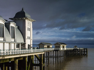 Penarth Pier bathed in sunlight after a gap appeared in an otherwise cloudy and overcast sky!