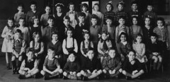 Class photo (theirhistory) Tags: children girls boys school junior infants form group dress jumper shorts shirt shoes wellies socks bow tie wellingtonboots hall primary
