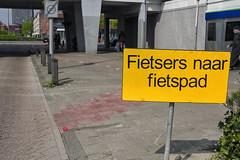 Cycle lane not ready (Arne Kuilman) Tags: fietsers sign bord augustallebéplein amsterdamnieuwwest oops error planning stoep curb street straat nikon 28mmf35 wide amsterdam netherlands nederland traffic