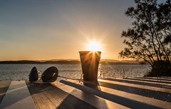 A cup of sunshine (OzzRod) Tags: pentax k1 smcpentaxa20mmf28 sunset sunburst shadows lake table silhouette belmontsouth lakemacquarie dailyinmay2017