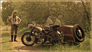 Old motorcycle with sidecar and the proud owner